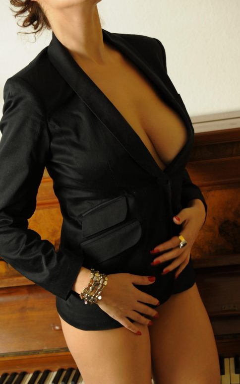 Berlin Escort, High class escort in Berlin, educated lady by piano