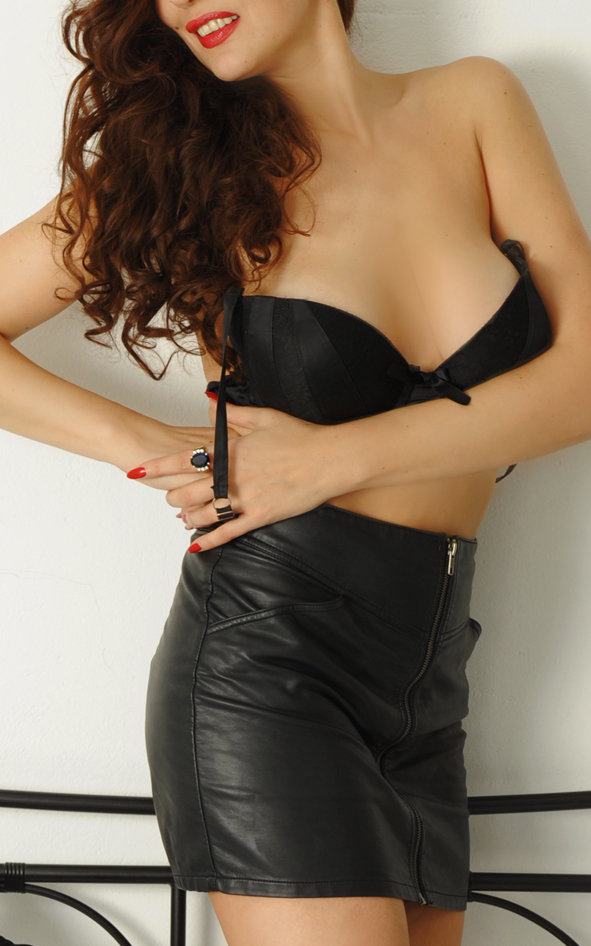 high class berlin escort with long brunette hair.