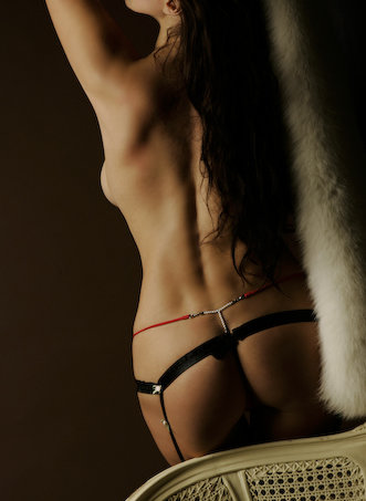berlin escort - long haired escort in fur and lingerie.